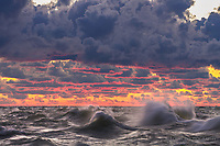 Watching waves on Lake Michigan roll and churn as the clouds are set afire after the sun had set
