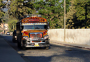 An early morning bus traveling through the network of one way streets in Antigua. Antigua Guatemala, Republic of Guatemala. 02Mar14