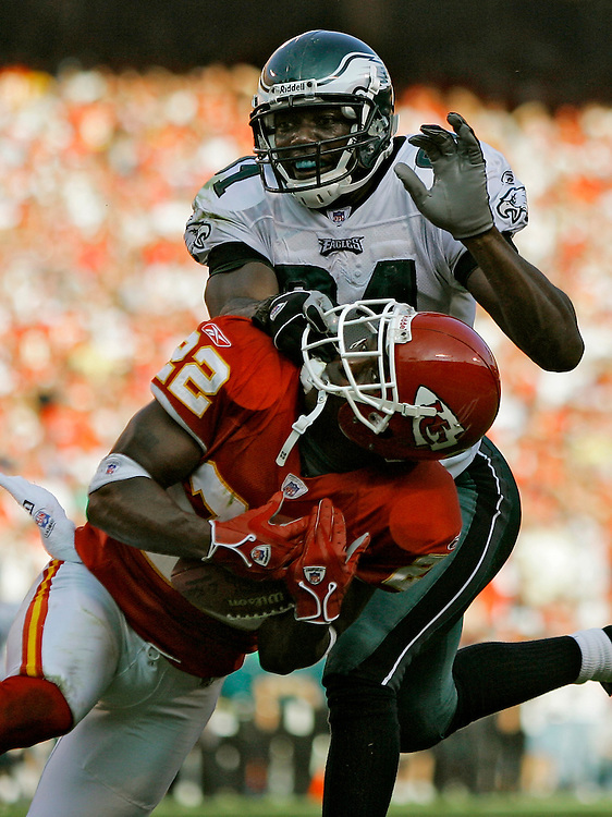 Kansas City Chiefs cornerback Dexter McCleon, lower, intercepted a pass intended for Philadelphia Eagles wide receiver Terrell Owens, top, in the third quarter Sunday evening, October 2, 2005 at Arrowhead Stadium. The turnover didn't help the Chiefs, who blew a 17 point lead and lost 37-31 to the Eagles.