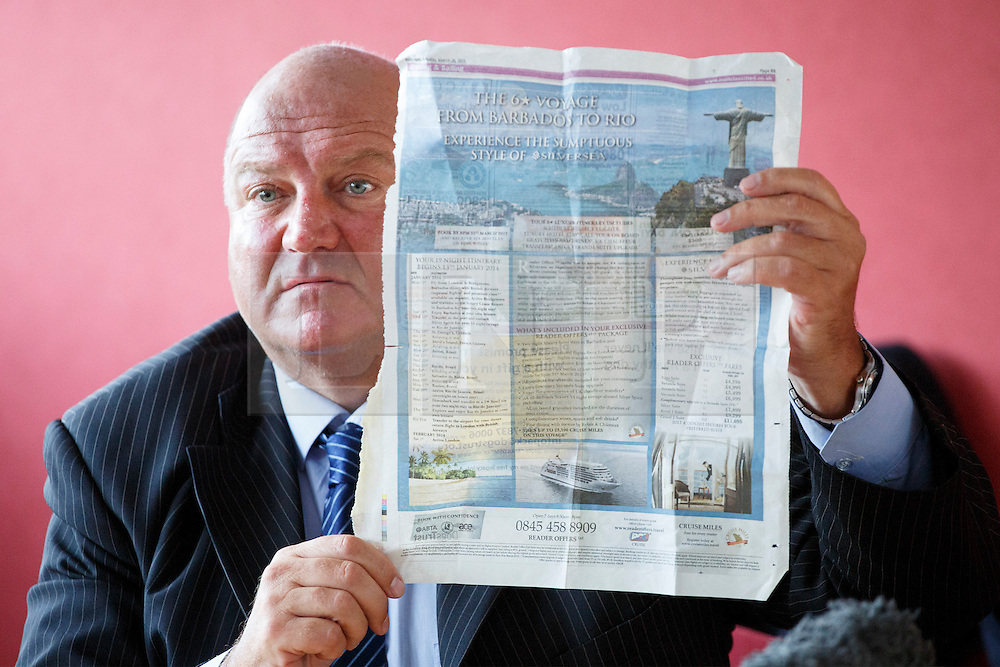 © licensed to London News Pictures. London, UK 03/02/2014. Bob Crow, General Secretary of the National Union of Rail showing a page of the Daily Mail newspaper whilst answering claims about his expensive holiday at TUC HQ in central London ahead of two planned 48-hour London Tube strikes. Photo credit: Tolga Akmen/LNP