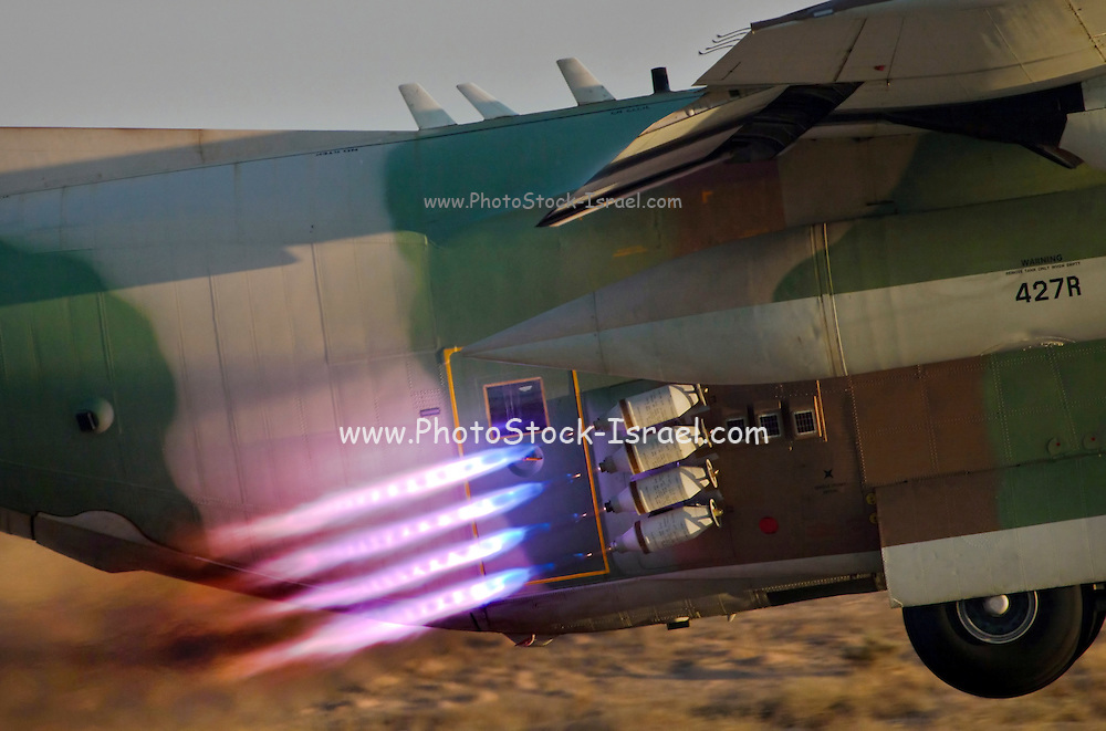 Israeli Air force C-130 Hercules 100 transport plane in flight take off booster can be seen
