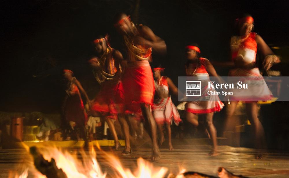Masai people dancing by the fire, Kenya
