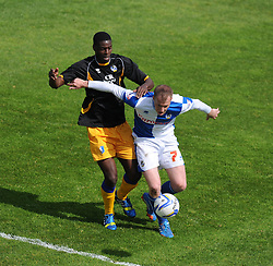 Bristol Rovers' Danny Woodards shields the ball from Mansfield Town's John Dempster - Photo mandatory by-line: Alex James/JMP - Mobile: 07966 386802 03/05/2014 - SPORT - FOOTBALL - Bristol - Memorial Stadium - Bristol Rovers v Mansfield - Sky Bet League Two