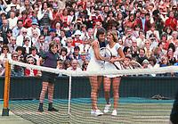 Tennis - 1978 Wimbledon Championships - Women's Singles Final<br /> <br /> The winner Martina Navratilova is congratulated by opponent Chris Evert at the net at the end of the match after winning 2-6, 6-4, 7-5.