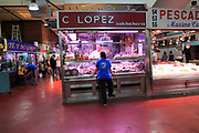 Inside mercado market fresh food stalls, La Latina, Madrid city centre, Spain