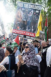 © Licensed to London News Pictures. 10/06/2018. London, UK. Supporters take part in the annual Al Quds day march in support of the Palestinian cause. A counter demonstration by far-right and Zionist groups also takes place. Photo credit: Ray Tang/LNP