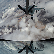 Royal Canadian Air Force CF-18 Hornets are refueled by a U.S. Air Force KC-135 Stratotanker<br /> assigned to the 340th Expeditionary Air Refueling Squadron,Mar 4, 2015,over Iraq. The Hornets are striking Da'esh targets in support Operation Inherent Resolve.(U.S. Air Force Photo by Staff Sgt. Perry Aston/not reviewed)