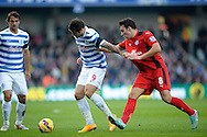 Charlie Austin of Queens Park Rangers holding the ball from Matthew James of Leicester City. Barclays Premier league match, Queens Park Rangers v Leicester city at Loftus Road in London on Saturday 29th November 2014.<br /> pic by John Patrick Fletcher, Andrew Orchard sports photography.