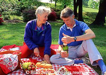 Active Aging Senior Citizens, Retired, Activities, Elderly Couple Picnics in Park