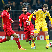 Turkey's Arda Turan (C) and Kazakhstan's Dmitri Shomko (L) during their UEFA Euro 2016 qualification Group A soccer match Turkey betwen Kazakhstan at AliSamiYen Arena in Istanbul November 16, 2014. Photo by Kurtulus YILMAZ/TURKPIX