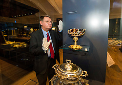 Pictured: Dr Godfrey Evans, Principal Curator of European Applied Art, checks  the  Hamilton-Rothschild Tazza display<br /> <br /> The National Museum of Scotland will launch ten new galleries on 8 July following a £14.1 million redevelopment in their 150th year.  <br /> <br /> Ger Harley   EEm 5 July 2016