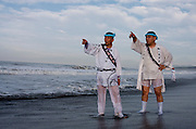 Mikoshi supporters direct mikoshi being carried into the sea during the Hamaorisai Matsuri that takes place on Southern Beach in Chigasaki, near Tokyo, Kanagawa, Japan Monday July 20th 2009. The festivals marks the celebration of Marine Day and the rescuing of a divine image that was washed ashore in the area. Over thirty Mikoshi or portable shrines are carried through the night from surrounding shrines to arrive on the beach for sunrise. There they are blessed and then carried into the surf to purify them.