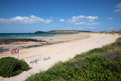 """© Licensed to London News Pictures. 11/05/2020. Newquay, UK. Constantine beach on the North coast of Cornwall is empty, the day after British Prime Minister Boris Johnson announced a 'road map' to lift lockdown restrictions due to Covid-19, (Coronavirus). A rise in """"staycations"""" - the concept of holidaying in your home country rather than travelling abroad - is expected, with many visitors planning to visit Cornwall. However, an ongoing campaign titled """"#ComeBackLater"""" is trying to persuade tourists not to visit the county until it is safe to do so. Photo credit : Tom Nicholson/LNP"""