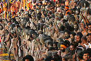 Nagas (Hindu ascetics who are followers of Sadhus) congregate to bathe in the Shipra River during the Kumbh Mela festival, Ujjain, Madhya Pradesh, India. The Kumbh Mela festival is a sacred Hindu pilgrimage held 4 times every 12 years, cycling between the cities of Allahabad, Nasik, Ujjain and Hardiwar.  Participants of the Mela gather to cleanse themselves spiritually by bathing in the waters of India's sacred rivers.  Kumbh Mela is one of the largest religious festivals on earth, attracting millions from all over India and the world.  Past Melas have attracted up to 70 million visitors.
