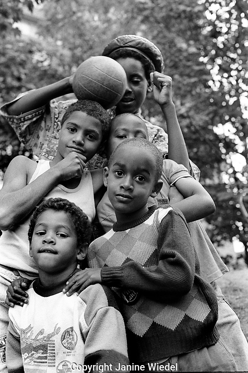 Group of Afro-Caribbean children playing and posing on an estate in South london