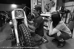 Last Chance! Scott Jones does some final prep on his bike with his wife Summer Jones at his side at Noise Cycles the night before Born Free 6. Santa Ana, CA. USA. June 26, 2014.  Photography ©2014 Michael Lichter.