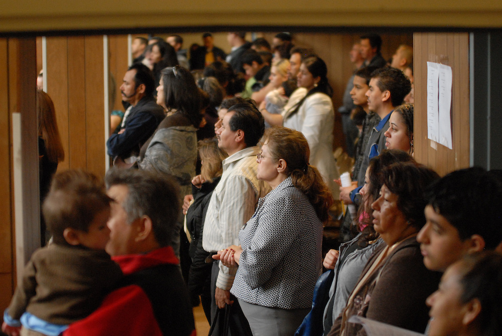A weekly mass in the gymnasium of St. Francis of Assisi Catholic Church is at standing room only capacity.