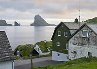 Street view from Böur in the Faroe Islands. Island Tindhólmur and Drangarnir Sea Stacks in background.