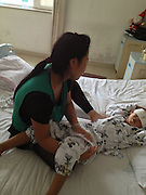 TAIYUAN, CHINA - AUGUST 28: (CHINA OUT) <br /> <br /> 6-year-old Boy Has Eyes Gouged Out<br /> <br /> Mother takes care of 6-year-old Guo Bin lying on a bed with his eyes covered with bandages at Shanxi Eye Hospital on August 28, 2013 in Taiyuan, Shanxi Province of China. The boy had his eyes gouged out after he was drugged near home in Fenxi county of Shanxi province on Saturday night. <br /> ©Exclusivepix