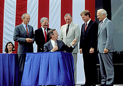 United States President George H.W. Bush signs a proclamation after announcing plans for the Space Exploration Initiative (SEI) on the the 20th anniversary of the Apollo 11 Moon landing at the National Air and Space Museum in Washington, D.C. on July 20, 1989. From left to right: Marilyn Quayle (seated); Apollo 11 Command Module pilot Michael Collins; NASA Administrator Richard H. Truly; President Bush; Apollo 11 Command pilot Neil A. Armstrong; U.S. Vice President Dan Quayle; and Apollo 11 Lunar Module pilot Edwin (Buzz) Aldrin.<br /> Credit: Robert Trippett / Pool via CNP /ABACAPRESS.COM