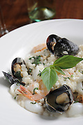 A serving of rice with Shrimps, mussels and cream sauce