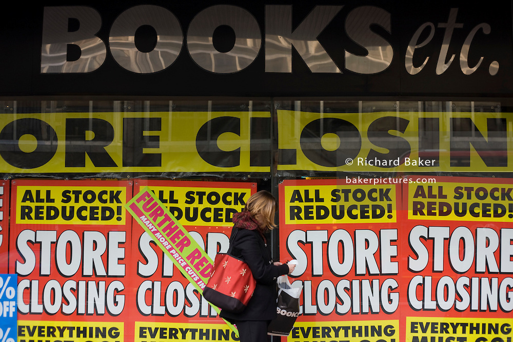 Closing down and all stock must go posters outside branch of 'Books Etc.' after the closure of parent company Borders.