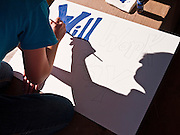 "09 OCTOBER 2011 - PHOENIX, AZ: KRYSTAL paints a sign that reads ""Will Work for Pay"" during an Occupy Phoenix sign painting party Sunday. About 50 people met in Steele Indian School Park in central Phoenix to paint signs for the Occupy Phoenix demonstration, which is expected to take place on Oct 15. Organizers are expecting more than 1,000 people to come downtown Saturday to protest against big banks and high unemployment.    PHOTO BY JACK KURTZ"