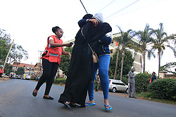 Jan 15, 2019 - Nairobi, Kenya - Family members seen reunited after walking away from an explosion from the attack..It started at around 3:30 pm when an unknown number of armed gunmen with one suicide bomber launched an attack on Dustil Hotel in Nairobi Kenya. The attack left 2 dead and several injured as the paramedics had to take action of helping the injured to safety hospitals around. (Credit Image: © Donwilson Odhiambo/SOPA Images via ZUMA Wire)