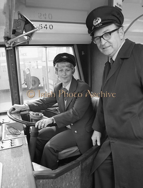 At the Wheel:..1980-05-02.2nd May 2012.02/05/1980.05-02-80..Photographed at Phibsborough Garage, Dublin...Photographed at Phibsborough Garage, Dublin...First Ever Woman CIE Dublin City Bus Driver, Joan Doran, 171 Ballyfermot Road, Dublin. Her first assignment is from Conyngham Road Garage on May 4. ..Inspector Bill McNally lends a helping hand. ..