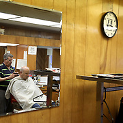 Greg Grime cuts Archbold resident George Jelen's hair at Archbold Barber Shop in Archbold, Ohio, on Wednesday, July 25, 2018. THE BLADE/KURT STEISS