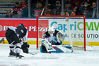 KELOWNA, BC - JANUARY 4: Roman Basran #30 of the Kelowna Rockets makes a save on a third period shot by Jackson Shepard #18 of the Vancouver Giants  at Prospera Place on January 4, 2020 in Kelowna, Canada. (Photo by Marissa Baecker/Shoot the Breeze)
