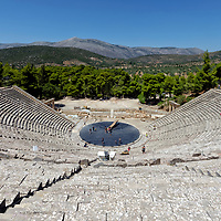 The ancient Greek theatre at the sanctuary of Asklepios (Asclepius). Epidaurus. Peloponnese. Greece. Dating from the 4th century BC, the theatre is perhaps the most outstanding from the ancient world due to its setting and harmonious design. The theatre's multi-tiered sweep of limestone, seats 14,000 and has near-perfect natural acoustics. The theatre as part of the Sanctuary of Asclepius is a UNESCO World Heritage Site.