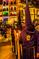Hooded Penitents (Nazarenos) in the procession of the Brotherhood (Hermandad) El Baratillo, Holy Week (Semana Santa), Seville, Andalusia, Spain.