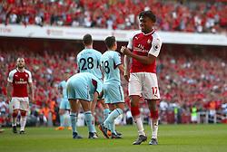Arsenal's Alex Iwobi celebrates scoring his side's fourth goal of the game