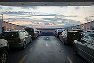 Baltic Sea - July 16, 2015: A car and passenger ferry en route at sunset from the city of Haapsalu to the island of Hiiumaa in Estonia.