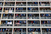 HANGZHOU, CHINA - NOVEMBER 26: (CHINA OUT) <br /> <br /> Clothes are aired in the sun and cover a residential building<br /> <br /> Clothes are aired in the sun at a residential building during a sunshine day on November 26, 2015 in Hangzhou, Zhejiang Province of China.<br /> ©Exclusivepix Media