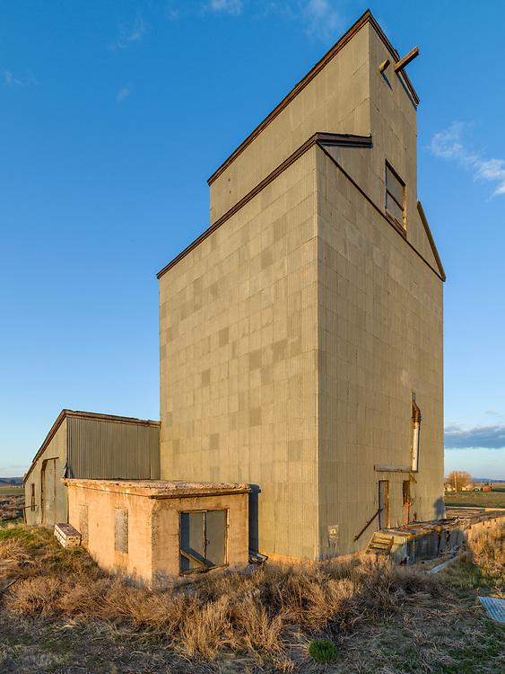 Corral Idaho Grain Elevator against blue morning sky on the Camas Prairie.  Open Editions