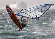 A windsurfer goes airborne in the wind off Marina Beach Park in Edmonds. In the first big storm of the fall, wind gusts were forecast to reach 45-50 mph in Western Washington. (Dean Rutz / The Seattle Times, 2020)