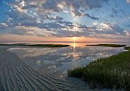 The sun drops toward Cape Cod Bay at Chapin Beach