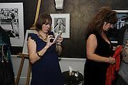 AMY MACLAREN TWEETING, The 2011 Groucho Club Maverick Award. The Groucho Club. Soho, London. 14 November 2011. <br /> <br />  , -DO NOT ARCHIVE-© Copyright Photograph by Dafydd Jones. 248 Clapham Rd. London SW9 0PZ. Tel 0207 820 0771. www.dafjones.com.