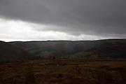 Heavy cloads and rain across a moorland landscape in Llanafan Fawr, Powys, Mid Wales, United Kingdom.