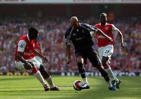 Photo: Tony Oudot.<br /> Arsenal v Bolton Wanderers. The Barclays Premiership. 14/04/2007.<br /> Nicolas Anelka of Bolton goes past Kolo Toure of Arsenal