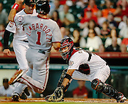 Aug 8, 2012; Houston, TX; USA; Houston Astros catcher Carlos Corporan (22) tags out Washington Nationals left fielder Stephen Lombardozzi (1) at home during the first inning at Minute Maid Park. Mandatory Credit: Thomas Campbell-US PRESSWIRE