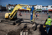 Digging work on the front at Southend-on-sea, Essex. The town could be described as run down as while there are some signs of affluence, these are few and far between. The predominant atmosphere is quite rough feeling and quite poor. Southend is a seaside resort that is very popular with people from the East side of London due to it's close proximity, just an hour away by train along the Thames Gateway. With the decline of seaside resorts, from the 1960s much of the centre was developed for commerce and many of the original features were destroyed through redevelopment or neglect.