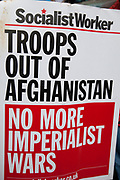 """Troops out of Afghanistan placard for Socilaist Worker. Protest in central London to mark 10 years of the conflict in Afghanistan. Musicians, actors, film-makers and MPs are joining protesters for the Anti-war Mass Assembly in Trafalgar Square. The Stop The War Coalition said up to 5,000 people were at the protest but a BBC correspondent estimated there were about 1,000 people in the square. The coalition says opinion polls show most British people want a """"speedy withdrawal"""" of UK forces. The demo brought together people from many groups in solidarity."""