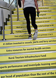 Edinburgh, Scotland, UK. 27 April, 2019. SNP ( Scottish National Party) Spring Conference takes place at the EICC ( Edinburgh International Conference Centre) in Edinburgh. Pictured; Delegates walk down stairs with the SNP's. claimed policy highlights listed