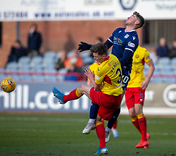 Partick Thistle's James Penrice and Dundee's Ross Callachan. Dundee 2 v 0 Partick Thistle, Scottish Championship game played 8/2/2020 at Dundee stadium Dens Park.