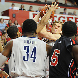 Connecticut Huskies guard/forward Niels Giffey (5) is harassed by Rutgers Scarlet Knights guard/forward Derrick Randall (15) during Rutgers' 67-60 upset victory over #8 UConn in NCAA Big East Basketball action at the Louis Brown Athletic Center in Piscataway, N.J. on Jan 7, 2012.