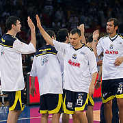Fenerbahce Ulker's Darjus LAVRINOVIC (L) and Sarunas JASIKEVICIUS (C), Kaya PEKER (R) during their Turkish Basketball league Play Off Final fourth leg match Galatasaray between Fenerbahce Ulker at the Abdi Ipekci Arena in Istanbul Turkey on Saturday 11 June 2011. Photo by TURKPIX