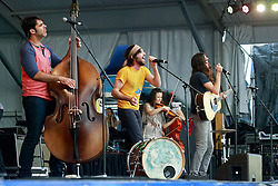 25 April 2014. New Orleans, Louisiana.<br /> The Avett Brothers play the New Orleans Jazz and Heritage Festival. <br /> L/R; Seth Avett, Scott Avett,  Tania Elizabeth  and Bob Crawford<br /> Photo; Charlie Varley/varleypix.com